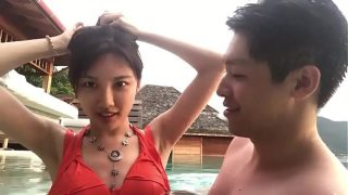 Chinese couple have fun on vacation